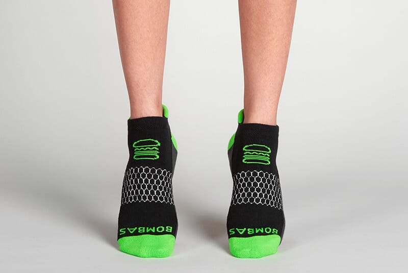 Image of the socks on female feet standing on tippy toes.