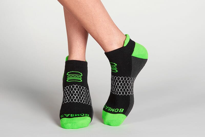 Image of the socks on female feet in a casual stance.