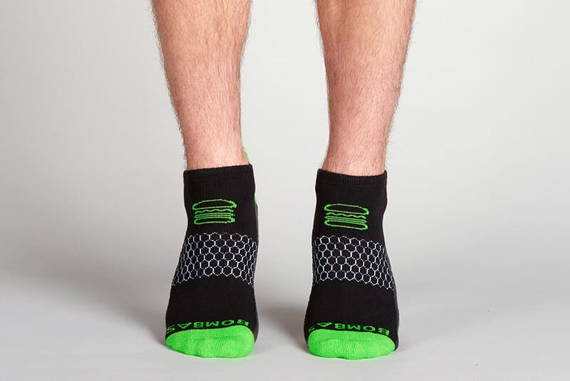 Image of the socks on male feet standing on tippy toes.