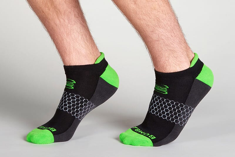 Image of the socks on male feet posing sideways.