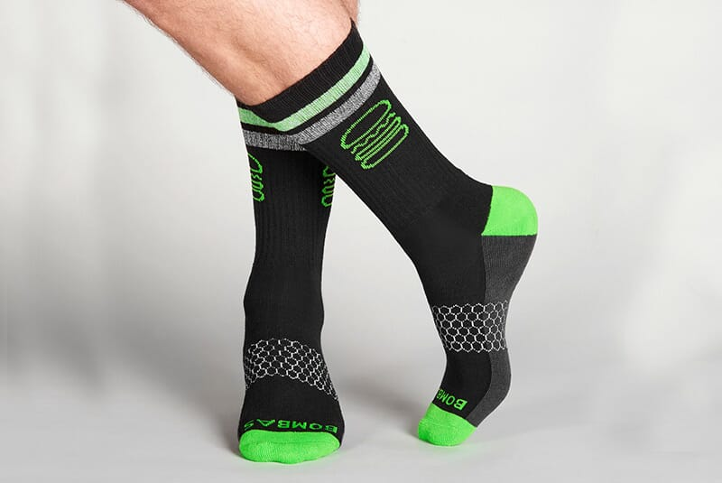 Image of the socks on male feet in a casual stance.