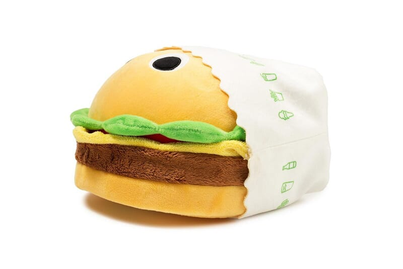 Image of burger plush laying down.