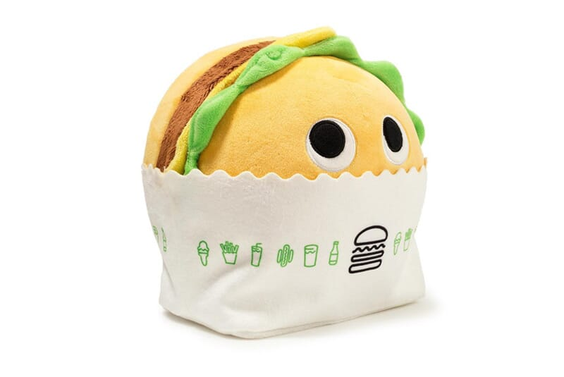 Image of side view of burger plush showing wrapper with logo.