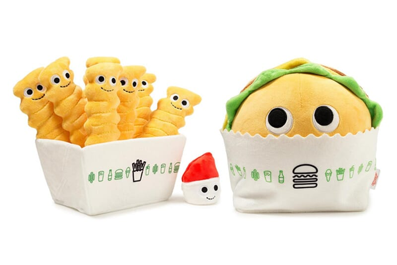 Image of fry plush with ketchup plush next to the burger plush.