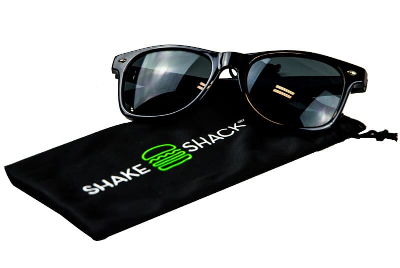 Black Shake Shack Shades with Shake Shack logo on case.