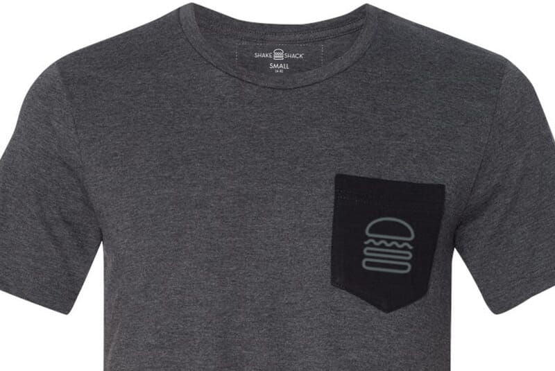 Image of dark grey heather tee showing burger on black pocket.