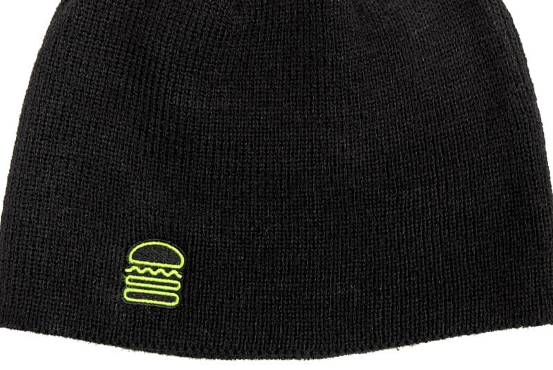 Full black burger beanie with Shake Shack Burger on bottom rim.