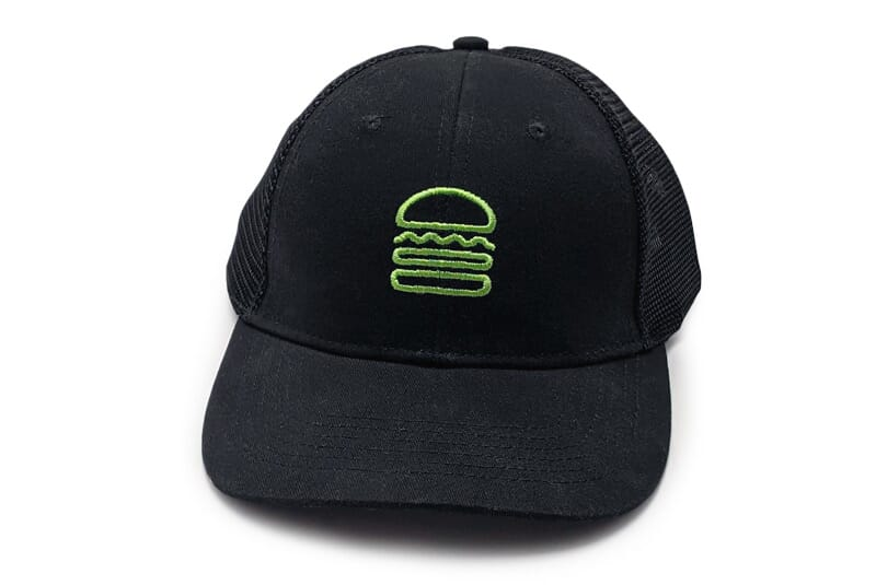 Image of team member hat with burger logo.